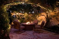 fire pit idea - like the whole 'tucked away' feeling and the arches