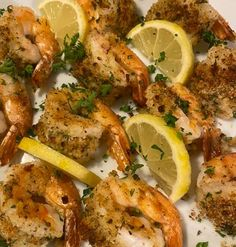 2 pounds jumbo shrimp (10 – 12 per pound (about 20)) 2 tablespoons dry white wine 1/4 teaspoon kosher salt 1/4 teaspoon crushed red pepper flakes 3 tablespoons whole wheat bread crumbs 2 tablespoons fresh minced parsley 1 1/2 tablespoons grated Pecorino Romano cheese 2 cloves garlic, minced 1/2 teaspoon dried oregano 1 teaspoon lemon zest 2 tablespoon extra virgin olive oil fresh lemon wedges