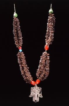 """Algeria   Necklace ~ """"tazlagt n-sháb"""" ~ from the Ouled Nail people   Silver, coral, clove (wood), beads and fiber"""