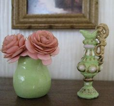 Dollhouse Miniature vase and paper flowers. Made the paper flowers from a Bonnie Lavish kit. Flower vase is polymer clay with varnish. The tall vase is a metal one I purchased from Mesh Miniatures and painted a la Alice Marques Gegers.