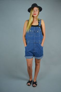 Awesome 1980s short overalls! Done in an oversized fit. Comfortable cotton denim. Adjustable straps. No Excuses patch on the center of back.