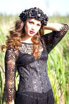 Black DIY floral crown with bell sleeve lace top and corset. Elegant vintage style outfit.