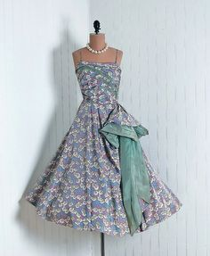 Party Dress: watercolor floral taffeta, thin straps heavily-sculpted bodice, draped peplum swag circle skirt.