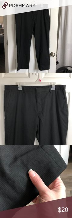 Men's CALVIN KLEIN Dress Pants, Black, size 38/30 Men's CALVIN KLEIN dress pants, black pinstripe size 38/30. Pants have been hemmed. I'm happy to give more exact measurements if you're interested! They have been worn a handful of times, but are still in very good condition. A bit wrinkled from being stored away, as they no longer fit my husband. Willing to consider any reasonable OFFERS! Calvin Klein Pants Dress