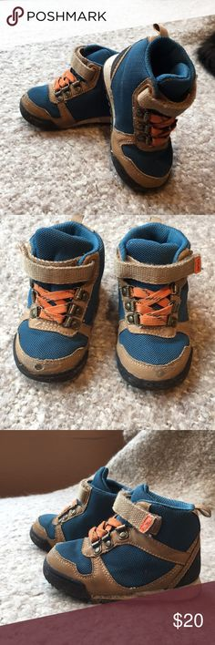HIKING BOOT for little humans by CARTERS We some sturdy shoe for beginning walker or runner. Gently loved with a few scuffs. High tops. Velcro closure to encourage kids to do it themselves. Carter's Shoes Sneakers