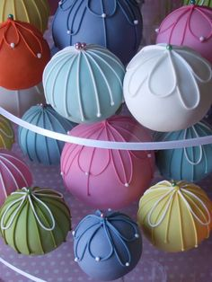 Temari cakes ... Inspired by the thousand year old Japanese craft of Temari, which is a threaded ball that is created by weaving colorful silk onto a small ball as a simple toy for children.