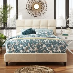 This upholstered bed adds elegance to any bedroom. The wooden bed consists of a linen upholstered headboard and a matching foot board. The soft headboard provides great comfort during naps and relaxat...