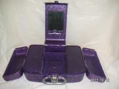 1 MULTI-COMPARTMENT MAKEUP STORAGE-ORGANIZER - Brand:  CABOODLES - Model:  LIQUID METALLICS 5667 -  UPC:  024099256674   -  Color:  PURPLE with SILVER-GLITTER - Unit has multiple Storage-Compartments.  has many other storage-organizer uses:  Craft Supplies, Office Desk Accessories, small Toys/Dolls, small Parts, Pageant CASE [MsFrugaLady on ebay]