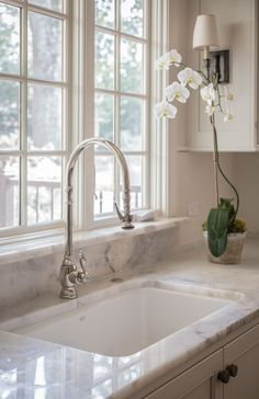 Marble backsplash and window sill to prevent paint peeling. Kitchen - McClure architecture