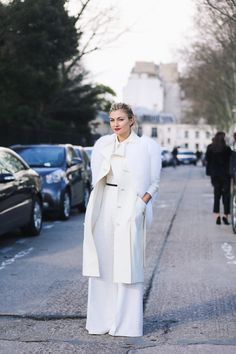 Plenty of ice-white, a touch of fur and striking red lippie make Nasiba Adilova's look a success.