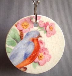 Broken china jewelry, Blue bird in cherry blossoms, upcycled recycled repurposed, plate necklace by CellarDoorShoppe on Etsy https://www.etsy.com/listing/238174401/broken-china-jewelry-blue-bird-in-cherry
