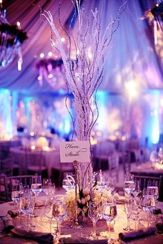 Purple and blue ombre uplighting at a wedding reception. This is good inspiration for a purple/blue toned wedding! Even those centerpieces are beautiful.