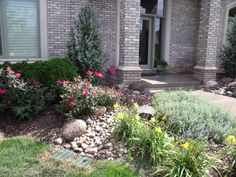 Front yard landscape construction project with garden path for Landscaping rocks daytona beach