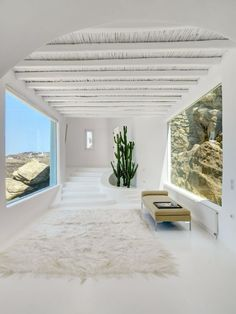Luxury homes for sale around the world this week: Mykonos, Greece All-white rounded walls, gleaming floors and thick wood-beam ceilings lead the way to beautifully exposed rock formations. Interior Architecture, Interior And Exterior, Interior Design, Garderobe Design, Greece House, Myconos, Greek Design, Vogue Living, Beach House Decor