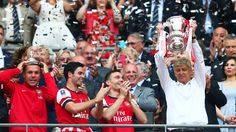 Arsene Wenger signs new three-year contract at Arsenal