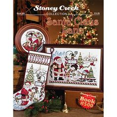 cover of Stoney Creek cross stitch book 500 Santa Claus Lane with annual stocking and 2016 Santa Christmas plate