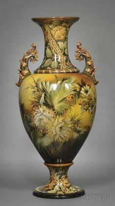 Large Doulton Lambeth Faience Floor Vase, England, c. 1893, baluster shape with allover polychrome enamel decoration by Florence Lewis of exotic flowers, foliage, and fruit, scrolled foliate handles, manufactured in five separate pieces, the neck, central body, foot, and each handle
