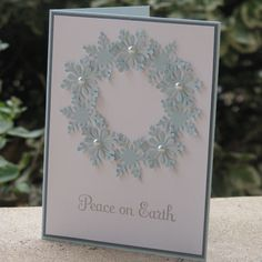 handmade Christmas card ... punched blue snowflakes form a wreath ... pearls ... lovely card!!
