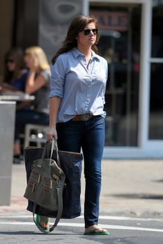 "Tiffani Thiessen Photos Photos - Tiffani Thiessen, who will reportedly be featured on the next season of ""Dancing with the Stars"", is seen out and about in NYC. The ""Saved by the Bell"" actress wore a light blue button shirt and skinny blue jeans. - Tiffani Thiessen Out and About in NYC"