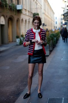 I love the idea of a demure Peter Pan collar blouse with a short black leather skirt…..sweet and a little sinister. - The Sartorialist