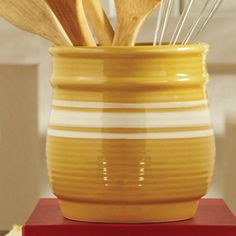 """Yelloware Crockery  Store your kitchen utensils or display a beautiful floral arrangement in this mustard stoneware piece. Microwave, dishwasher safe. 6""""dia. x 6""""h"""