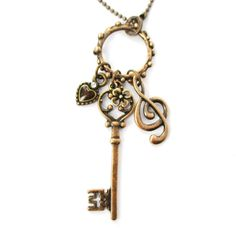 Skeleton Key Heart and Treble Clef Pendant Necklace in Brass | DOTOLY