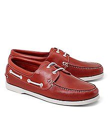 Classic boat shoe design with washed leather upper and leather lining. Updated colors with white stitching, laces and rubber soles. Imported. - 11