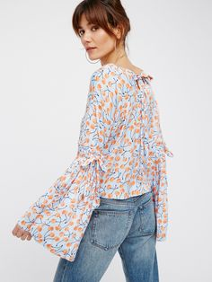 Cherry Pie Top | Super silky top featuring a sweet cherry print with dramatic, retro-inspired bell sleeves.    * Soft V-neckline   * Adjustable ties at the arms and back keyhole cutout