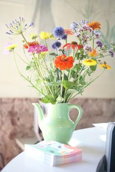 Summer flowers! This is what a pretty tea pot does best, when it's not serving at a garden tea party.
