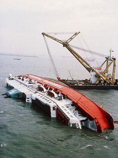 The wreck of the Herald of Free Enterprise roll-on roll-off car and passenger ferry two days after it capsized near Zeebrugge on the of March killing 193 people. Abandoned Ships, Abandoned Places, Titanic Underwater, Ship Breaking, Under The Ocean, Merchant Marine, Ghost Ship, Shipwreck, Water Crafts