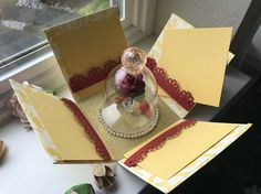 Included is one beautiful and elegant exploding box that is not just a box but also a card that can be used as a wedding invitation or an anniversary card - The box is all handmade with high quality cardstock, decorated with ribbon, pearls and rhinestones - On the sides of the inner box,