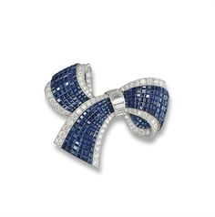 A 'MYSTERY-SET' SAPPHIRE AND DIAMOND CLIP BROOCH, BY VAN CLEEF & ARPELS