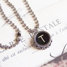Hey, I found this really awesome Etsy listing at http://www.etsy.com/listing/158798663/vintage-typewriter-key-necklace-letter-t