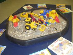 Stones and assorted diggers with a collection of related books to look at-half stones half mud Activities For Boys, Infant Activities, Transport Topics, Childcare Rooms, People Who Help Us, Tuff Spot, Block Area, Preschool Arts And Crafts, Block Play