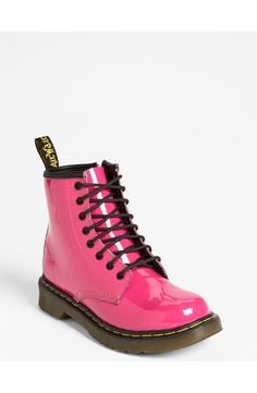 A pink patent finish updates this signature chunky boot by Dr. Martens. The little one will look trendy and cute in these darling shoes for back to school.