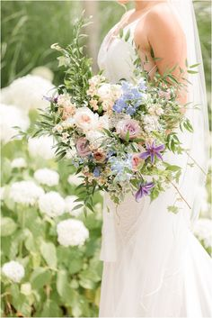 bride holds bouquet of roses and wildflowers for summer wedding in New Jersey   Summer Minerals Resort wedding in Vernon NJ photographed by Idalia Photography, New Jersey wedding photographer. Planning an outdoor summer wedding? Find inspiration here! #MineralsResortWedding #RainyWeddingDay #SummerWeddingInspiration #IdaliaPhotography Nj Wedding Venues, Lodge Wedding, Floral Wedding, Wedding Bouquets, Wedding Flowers, Vernon Nj, Crystal Springs Resort, Wildflowers, Summer Wedding