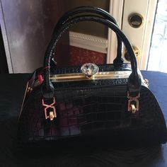 Purse Black vegan leather purse. Comes with long shoulder strap. Bags Shoulder Bags