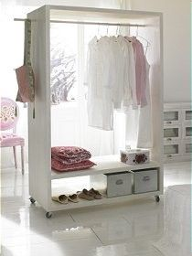 "Obsessed with these ""mobile closet""/ hanging racks.... great way to set up your wardrobe for the week."