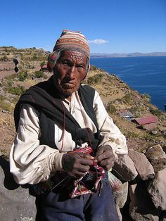 Andean style of knitting with yarn wrapped around your neck, purled inside out…