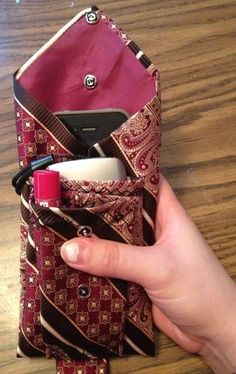 I can put my Chapstick, camera, and my phone (in the back pocket) in my pouch! And any debit cards and cash as well! It can hold quite a bit...