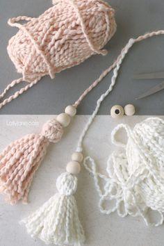diy wood bead yarn tassel - Lolly Jane Diy Tassel Garland, Wood Bead Garland, Beaded Garland, Tassels, Garlands, Christmas Bead Garland, Fabric Garland, Diy Christmas, Holiday