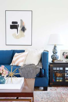 Make your living room pop by mixing bright colors with bold prints