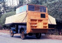 This is the Kamper Kar, with fold down side and a poptop. It was built on a Model T platform