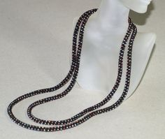 Starry Night is the perfect name for this beautiful bead crochet necklace, created from opaque black seed beads and a sprinkling of ten different shades of metallic finish beads. Chic, simple, and ultra modern, this piece can be worn as a necklace or a bracelet; and no matter how you choose