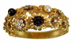 Found on EstateSales.NET: 18k Antique Floral Bangle w/ Diamonds, Pearls