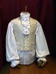 CHORRERA corbata de encaje que bordea toda la abertura vestical de la camisa