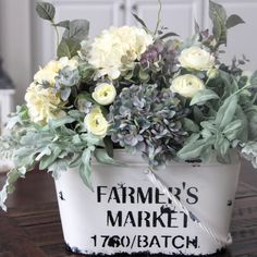 Love the rustic pail this hydrangea centerpiece is in.  The perfect farmhouse arrangement.