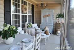 Back porch : Hutch, dining table & chairs, chair with coffee table and even a sofa on the other end.
