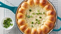 This skillet dip has it all! A creamy chicken dip with a spicy kick gets surrounded by cheese-stuffed sweet Hawaiian biscuits and baked—it's so easy, the hardest part about making it is waiting for it to come out of the oven! Pillsbury Recipes, Appetizer Recipes, Mexican Appetizers, Dip Recipes, Skillet Recipes, Casserole Recipes, Chips And Salsa, Hors D'oeuvres, Cinco De Mayo