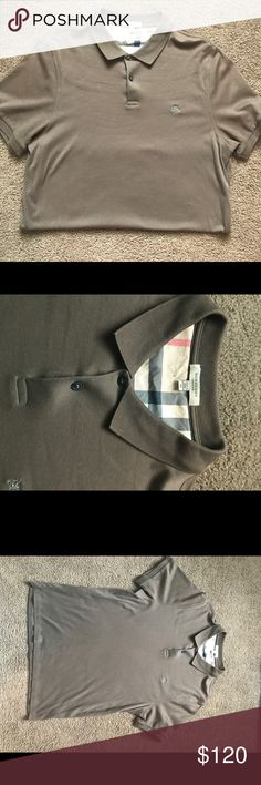 Men's Burberry polo Beautiful Burberry polo.  Worn once!  XL but runs small and would fit a L best.  Thanks for shopping! Burberry Shirts Polos